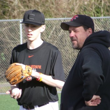 MTHS baseball coach Andrew Watters talks to sophomore shortstop Drew Serres.