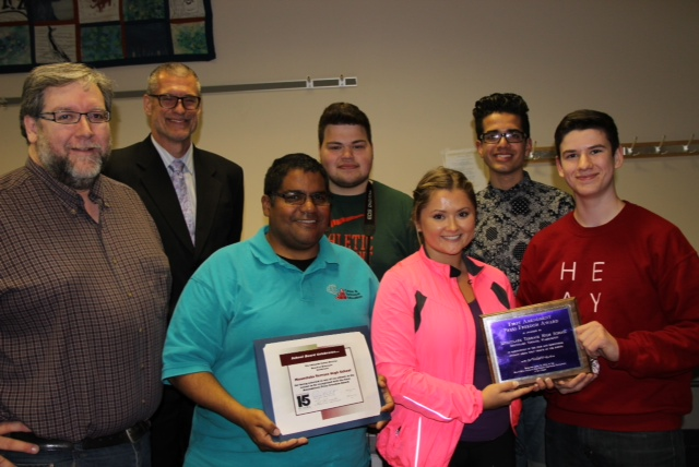 Mountlake Terrace students and staff were honored by the Edmonds School District Board during Tuesday's meeting for being selected as one of the six schools in the nation to be recognized with the First Amendment Press Freedom Award. Pictured are left to right, back row: Principal Greg Schwab, T.K. Johnson and Will Khadivi. front row: Teacher Vince DeMiero, teacher Angelo Comeaux, Joy Gardner and Nick Fiorillo. (Photo courtesy of the Edmonds School District).