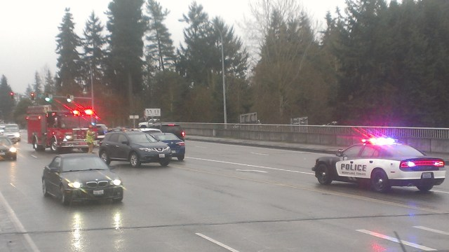 Fire District 1 and Mountlake Terrace Police responding to a two-car accident that blocked a center lane on the 220th Street Southwest overpass earlier this month. (Photo by Doug Petrowski)
