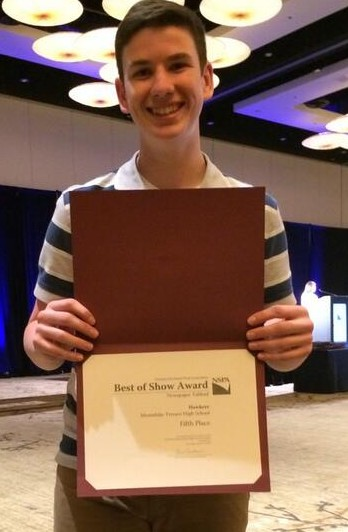 Hawkeye editor Nick Fiorillo holding the newspaper's fifth place award in the Best of Show category.