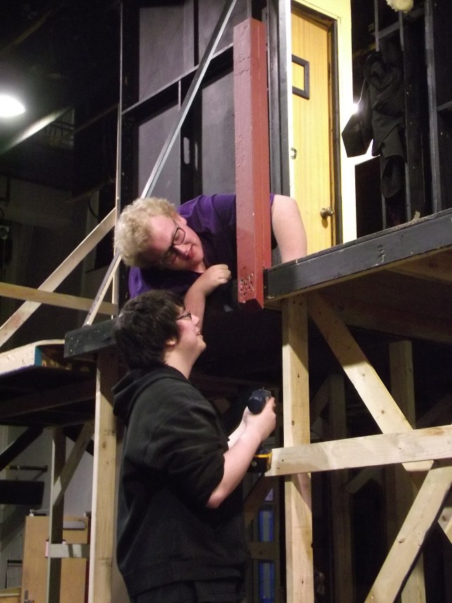 "Mountlake Terrace High School students Kyle Henderson (above) and Nick Van Akker work on building safety rails for the set that will be used in the school's drama department performances of ""Noises Off,"" scheduled for later this month."