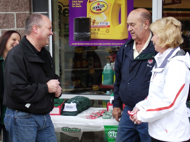 O'Reilly Auto Parts store Manager Amy Nestling, District Manager Jim Murray, Mountlake Terrace Mayor Jerry Smith and Mountlake Terrace City Manager Arlene Fisher (left to right) share a laugh at the auto parts store ribbon-cutting event on Saturday.
