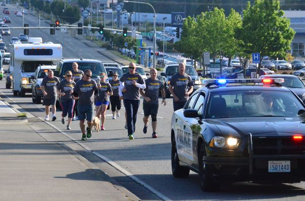 Police pound the pavement on Highway 99, all part of the Law Enforcement Special Olympics Torch Run.  The run ends at Joint Base Fort Lewis/McChord, site of this weekend's Special Olympic games involving athletes from throughout the region. (Photos by Larry Vogel)