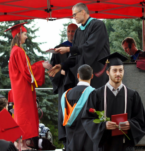 A graduate receives her diploma from MTHS Principal Greg Schwab.