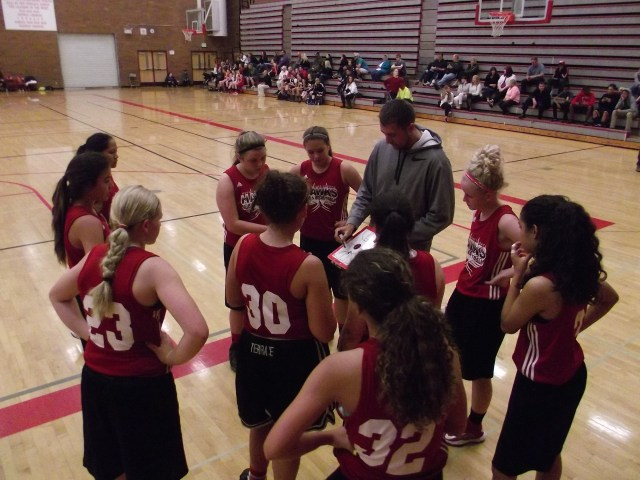 Coach Zach Wilde goes over strategy with the MTHS Hawks during a timeout in their game against Ingelmoor in the Edmonds Summer Shootout Friday afternoon. Tournament games continue on Saturday and Sunday all around South Snohomish County.