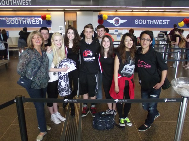 Eight students from the Mountlake Terrace High School drama department departed Sea-Tac Airport Sunday morning to travel to the Educational Theatre Association's Thespian Festival in Lincoln, Nebraska. More than 2,800 students and educators are expected to attend the week-long conference that will feature more than 100 workshops and classes, student performances on four stages, and student auditions for college scholarships and admissions. Those from MTHS attending are (from left to right) MTHS instructor and drama department head Jeannie Brzovic, Nick Van Akker, Amanda Petrowski, Erin Hyatt, Everett Amundson, Joe Koeing, Emily Davidson, Danielle Hirano and Matt Sythandone