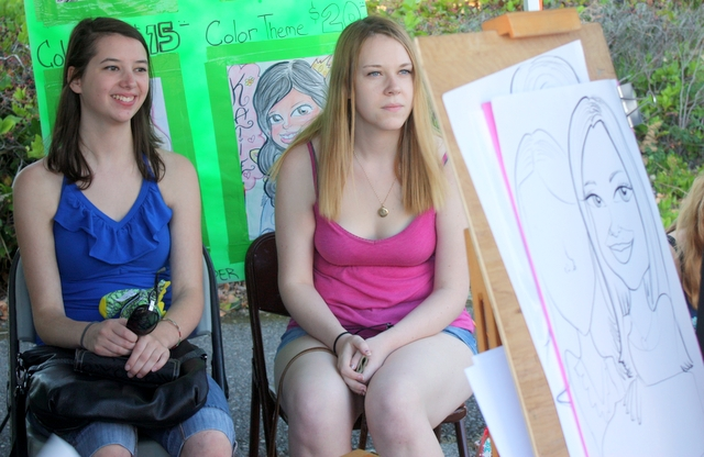 Shannon and Tara have a caricature of themselves drawn at Monster Caricatures.