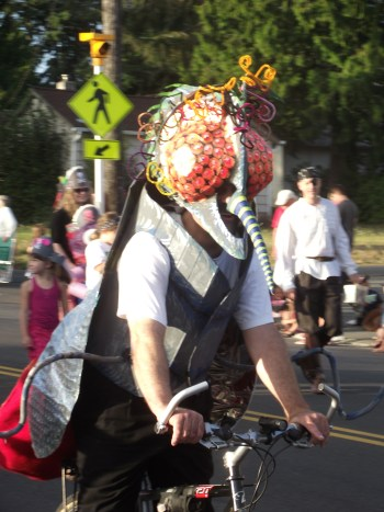 A Spider man or the equivalent rode a bicycle in the parade. (Photos by Doug Petrowski)