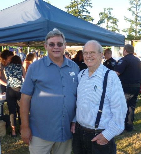Current Brier Mayor Bob Colina and Brier's first Mayor Dick Bals pose for a photo at Tuesday's National Night Out event in Brier Park.