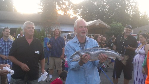 Brent Waters, of Brier, receives the grand prize in the Brier Salmon Derby. Mountlake Terrace's QFC donated the salmon for the free drawing. (Photo by Doug Petrowski)