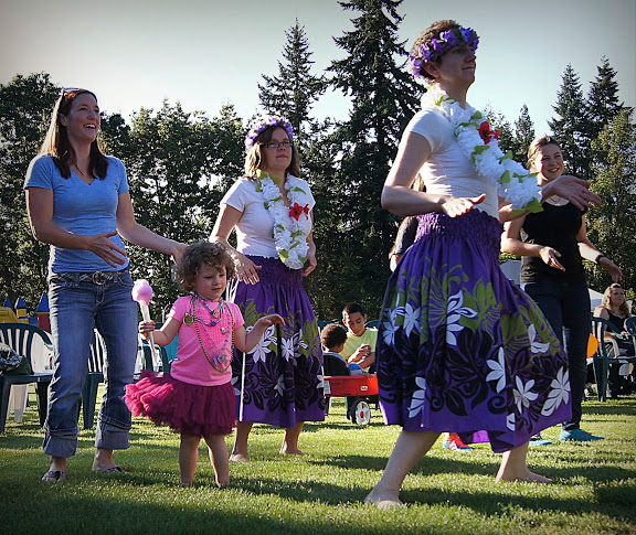 A young girl dances with Miley's Hula Sisters from the MLT Recreation Pavilion.