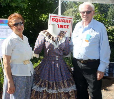 Freewheelers Square Dance Club members M.B. Webb and Dwight Koch (right) pose with a square dancing dress.