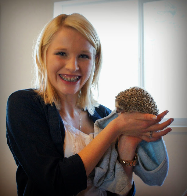 Amanda was happy after her hedgehog was blessed.