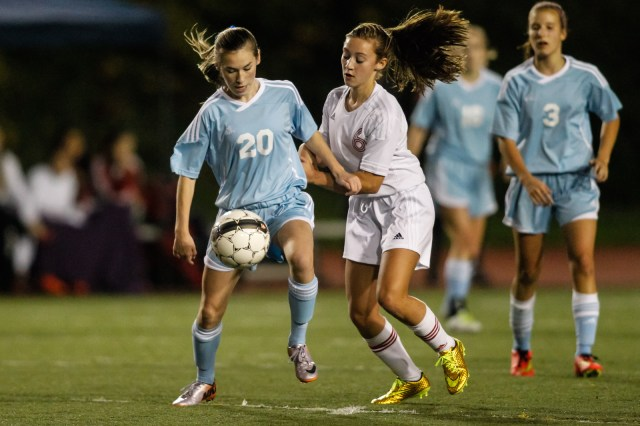 Meadowdale's Mykaela Marsh and Terrace's Bryana Cockbain battle for possession.