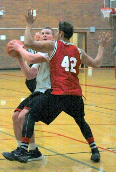 Mountlake Terrace graduate Loren Lacasse (left) eyes the basket.