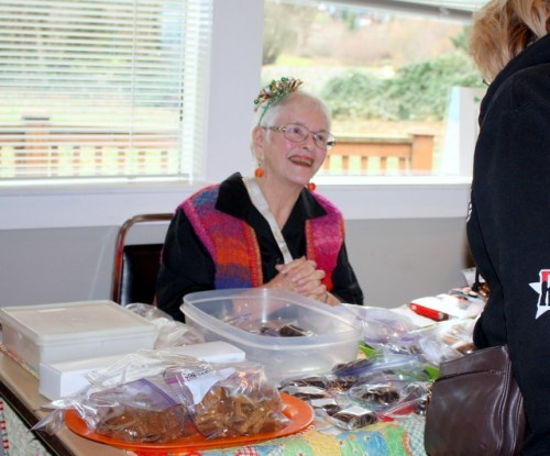 Sharon Henley talks with a customer about her homemade candy. She also offers dog treats.