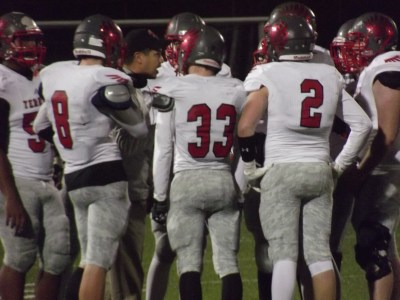 Coach Tony Umayam tries to fire up his defensive unit during Friday's game at Oak Harbor.