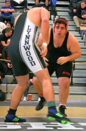 Mountlake Terrace's Taylor Murgallis (right) faces Lynnwood's Mahdi Shahhosseini in the third/fourth place 285-pound match Saturday at Lynnwood High School.