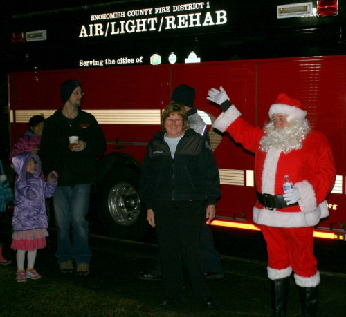 Santa Claus hitched a ride with Snohomish County Fire District 1 to the Evergreen Playfields.