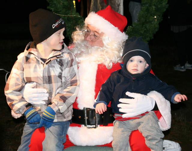 Jack Chalmers and younger brother Luke Rock Chalmers (right) visit with Santa Claus during Mountlake Terrace's Holiday Tree Lighting and 60th Birthday Celebration Friday evening at the Evergreen Playfields in Mountlake Terrace.