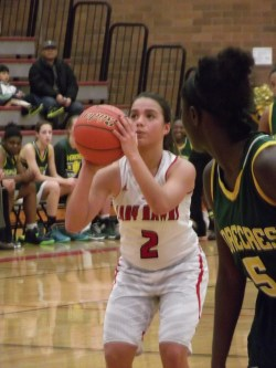 Claire Zucker, who led Terrace in scoring with eight points, lines up a foul shot while Shorecrest's Worrie Njadoe looks on.