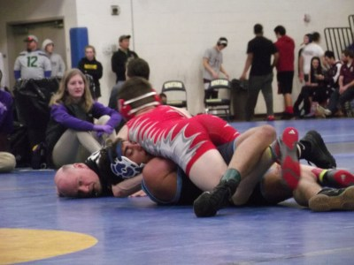 Hawk Pavil Oliferovskiy (in red) puts Interlake's Devansh Dwivedy in a near-fall position just before getting the pinfall victory at 1:25