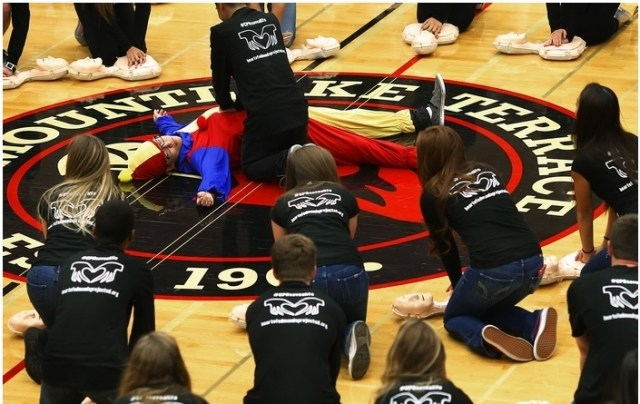 Would you know what to do if someone collapsed? That's the question students were asked at Lynnwood High School when an AED/CPR flash mob invaded their gym during an assembly in late 2014. The events were organized by the Heart of Edmonds School District & Community Heart Safe Project and Nick of Time Foundation, a non-profit organization. Melinda Truax helped organize each event after her 16-year-old son Matthew collapsed on the Meadowdale High School track in September 2013 and died from sudden cardiac arrest. Everyone is invited to attend the Save A Life; Equip a Hero gala fundraiser planned for Feb. 28 at the Lynnwood Convention Center. Money raised will be used to purchase automated external defibrillators for all district schools. You can purchase gala tickets or make a donation at www.heartofedmondssd.org