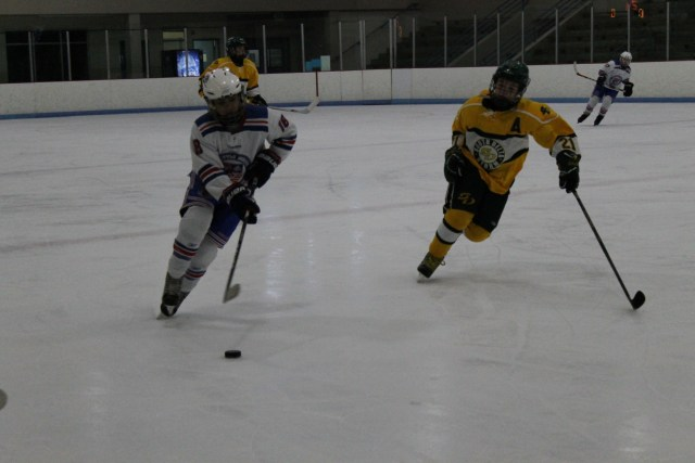 Players from the Seattle Junior Hockey Association Pee Wee (12) AAA team and the South Delta Storm chase the puck in a matchup between the two squads on Feb. 28. The Storm defeated the SJHA Pee Wee AAA team 4-0.