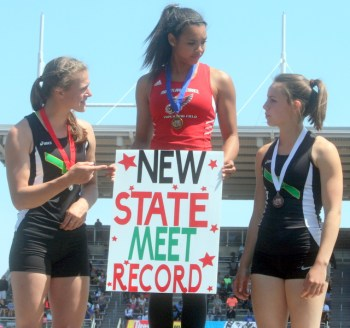 Mountlake Terrace's Chinne Okoronkwo (center) won the 3A pole vault with a state meet record of 13 feet, 3 inches. Laura Marty and Ginger Markow (right), both of Bishop Blanchet also broke meet records with their performances.
