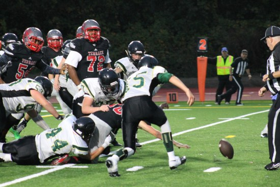 Mountlake Terrace Hawk Garrett McDowell loses the ball inside the five-yard line Friday night at Edmonds Stadium. Marysville-Getchell Charger Cody Day recovers the ball to end the Hawk scoring threat. (Photo by Doug Petrowski)