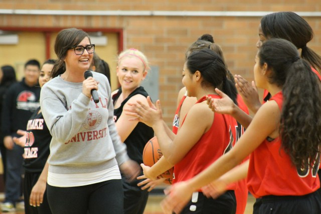 MTHS Girls Basketball Coach Jesica Anissipour (left) introduces her 2015-2016 varsity squad at Jam Session XXII on Nov. 24. (Photo by Amanda Petrowski)