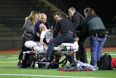 Kvinge is lifted onto a stretcher after suffering a left calf injury on Oct. 20 in a Wesco League match at Edmonds District Stadium between Mountlake Terrace and Edmonds-Woodway.