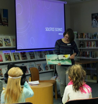 """Brier librarian Heather Orsen reads from the children's book """"Raven"""" to explain why it's dark in the winter."""