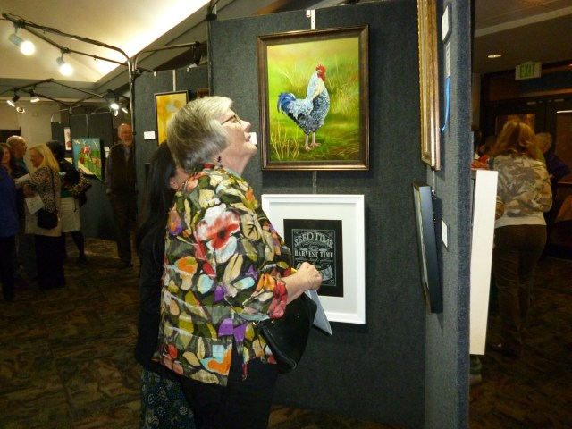 An attendee browses exhibits at the 2015 Arts of the Terrace. (Photo courtesy City of Mountlake Terrace)