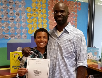 Torren with his dad. (Photo courtesy Sno-Isle Libraries website)