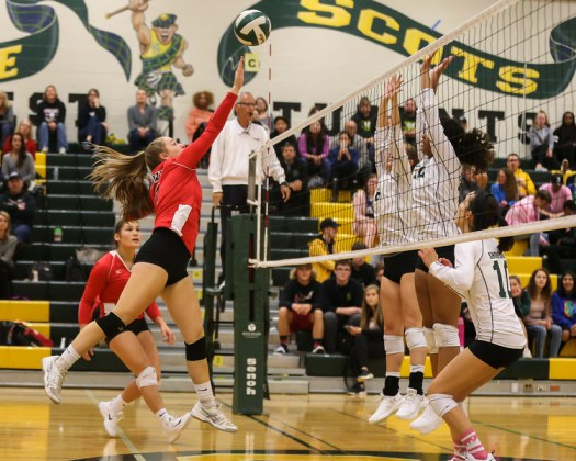 Jamie Bingaman puts the ball over Shorecrest's blockers for a point