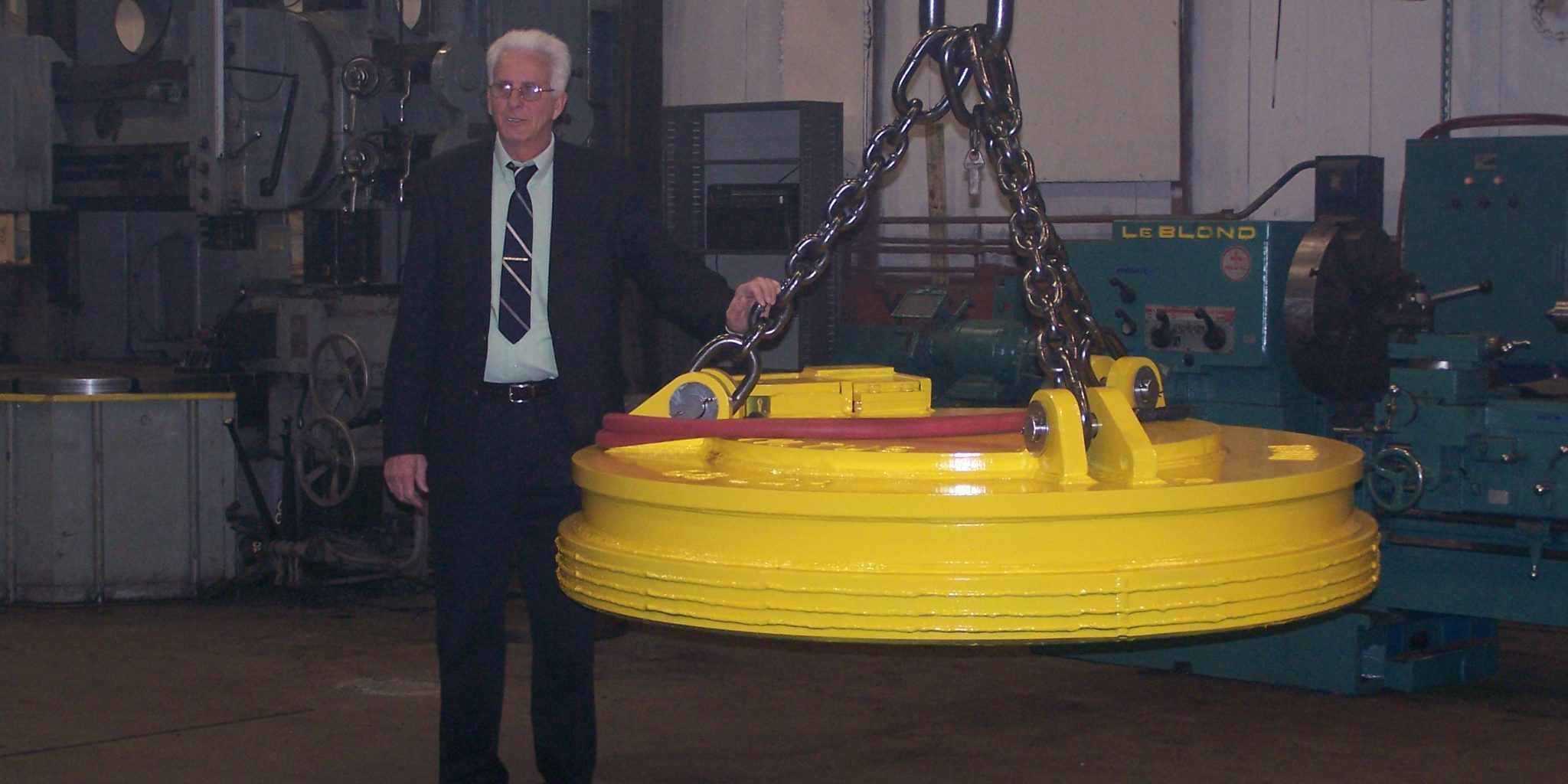 Engineer Dan Love stands next to the first magnet built at MLTUS