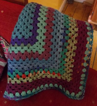 Comfort blanket goes with sofa