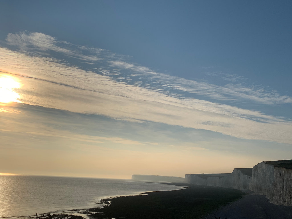 The sun setting at Birling Gap, with the Seven Sisters cliffs in view