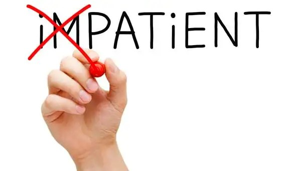 """Red marker pen changing the word """"impatient"""" to """"patient"""""""
