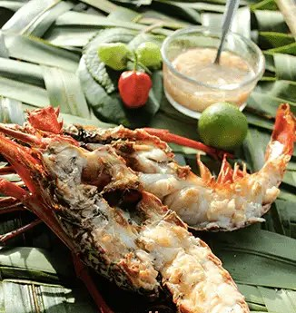 Langouste barbecue tradition cuisine antillaise