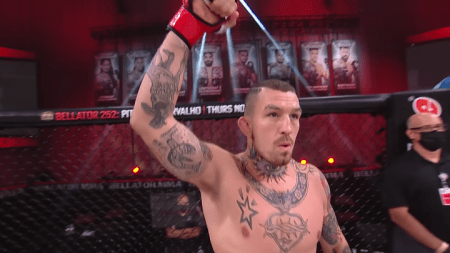 Austin Vanderford raises his right fist while being introduced in the Bellator cage.