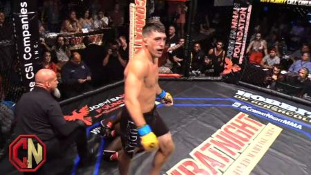 Preston Parsons walks away from a grounded opponent after the referee stopped the fight.