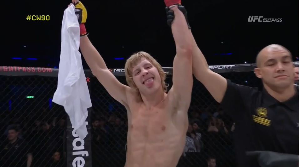 Paddy Pibmlett gets his arm raised in an MMA cage.