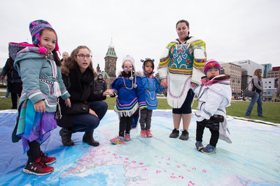 Students from the Ottawa Inuit Children's Centre explore the Indigenous Peoples Atlas of Canada's Giant Floor Map at the launch of the educational materials on Parliament Hill in Ottawa. (CNW Group/Royal Canadian Geographical Society)
