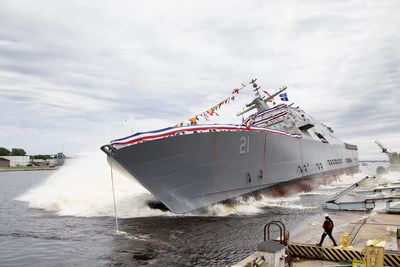 The 21st Littoral Combat Ship, the future USS Minneapolis-Saint Paul, launches sideways into the Menominee River in Marinette, Wisconsin, on June 15.