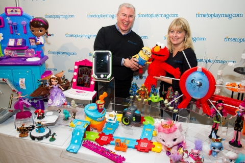 Chris Byrne (L), content director of TimetoPlayMag.com, aka The Toy Guy (R) and Laurie Leahey (R), s ...
