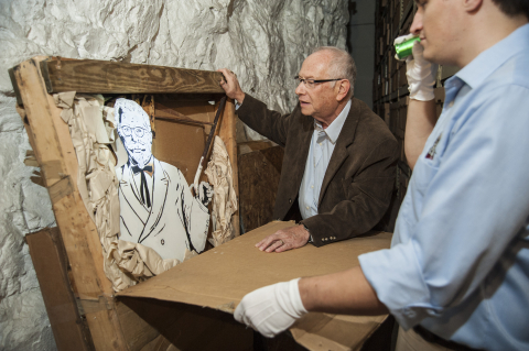 Historian Barry Bernson and KFC employee Trevor Park, right, looking at a rare, 50-year-old Colonel...