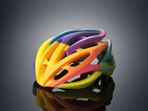 Bike helmet 3D printed on the Objet500 Connex3 Color Multi-material 3D Printer in one print job usin ...