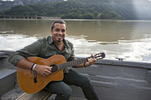 """Millo Torres during the filming of Popular's music special """"Qué lindo es Puerto Rico"""" in the Lago Do ..."""